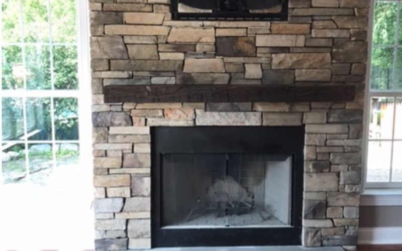 stone fireplace in modular container home